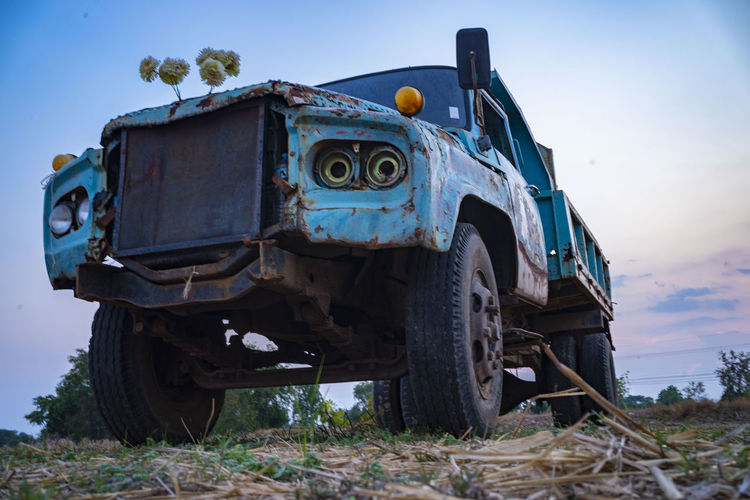 Old truck parked in rice fields in thailand.