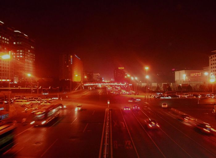 High Angle View Of Illuminated City Street At Night