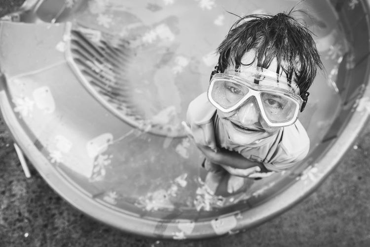 Portrait Of Smiling Boy Wearing Scuba Mask While Standing In Wading Pool