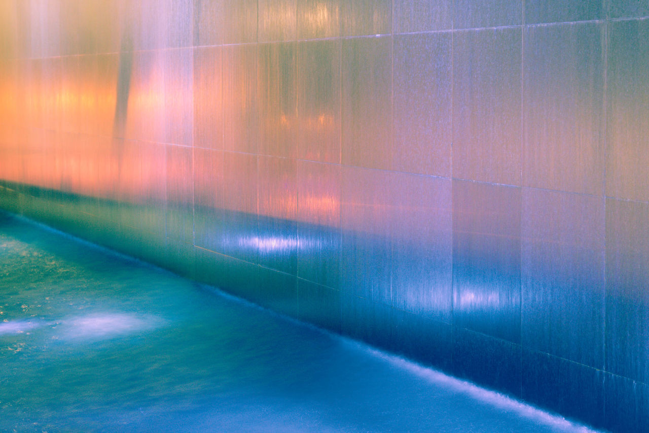 multi colored, wall - building feature, no people, full frame, pattern, backgrounds, indoors, architecture, flooring, reflection, day, tile, wall, illuminated, abstract, nature, light - natural phenomenon, built structure, direction, nightlife