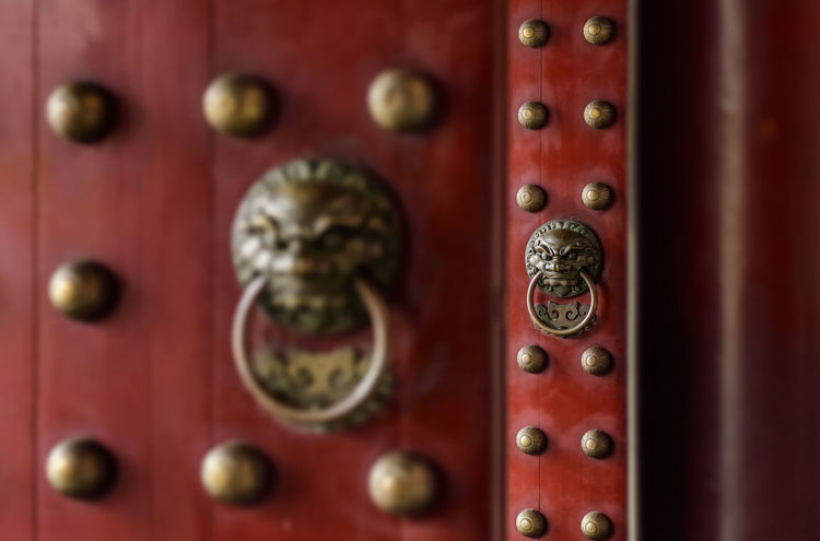 scenes at the Buddha Tooth Relic Temple in SIngapore Brass Buddhism Buddhist Temple Chinese Temple Doors Knocker Lion Place Of Worship Red Temple Temple Doors Traditional Architecture The Secret Spaces