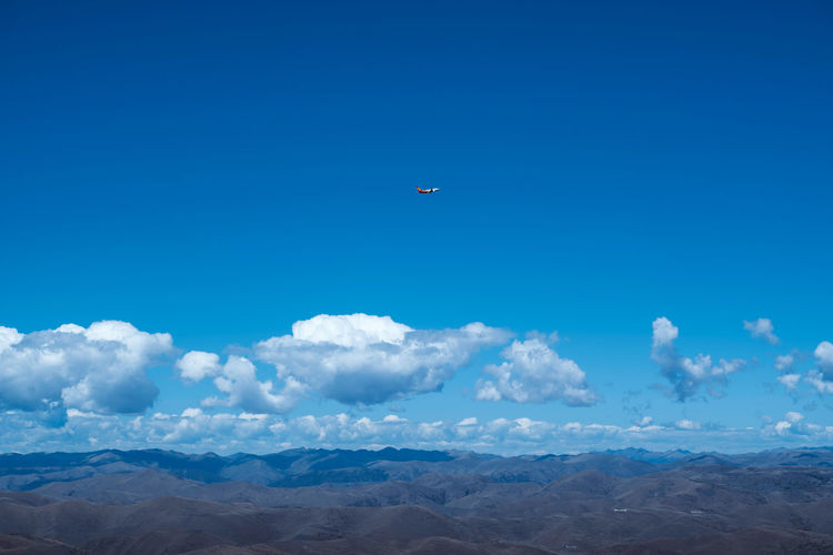 Blue sky, white clouds, airplane, travel Landscape Outdoors Day Nature Airplane Transportation Flying Mode Of Transportation No People Travel Sky Cloud - Sky Beauty In Nature Blue Scenics - Nature Tranquil Scene Tranquility Low Angle View Mountain Mountain Range