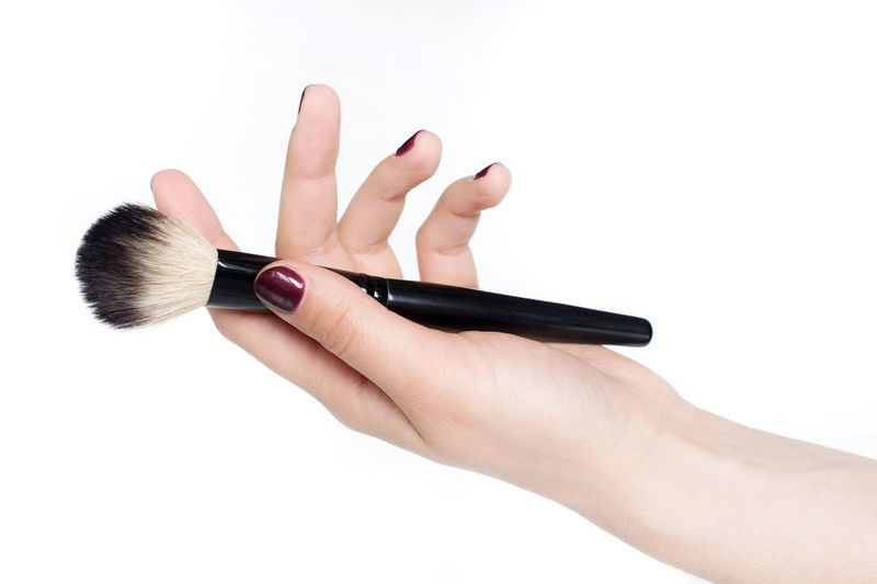Young woman holding a makeup brush Cosmetics Makeupartist Copy Space Human Hand Hand Make-up Brush White Background Studio Shot Beauty Product Make-up One Person Close-up Holding Fashion Women Blush - Make-up