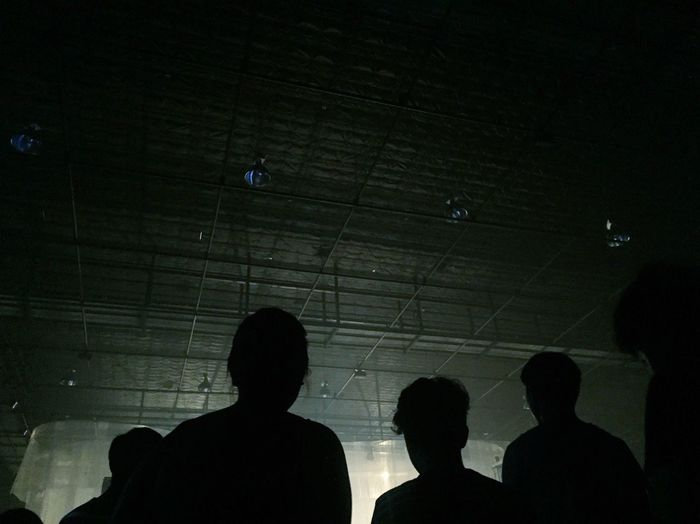 Low angle view of silhouette people standing in corridor