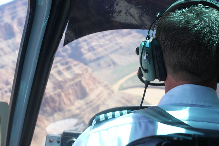 Helicopter pilot Driving Ear Defenders Flying Grand Canyon Headphones Helicopter Mode Of Transport Pilot Transportation Travel Traveling