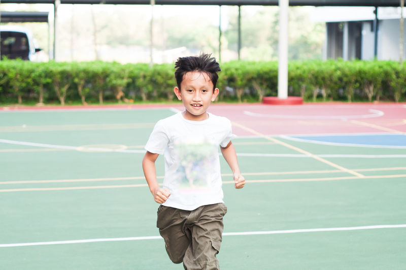 Boy running at basketball court