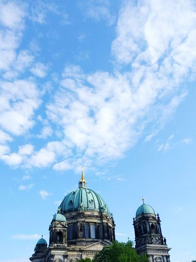 Low angle view of berlin cathedral against cloudy sky