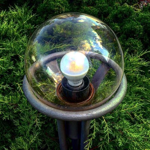 High angle view of crystal ball on grassy field