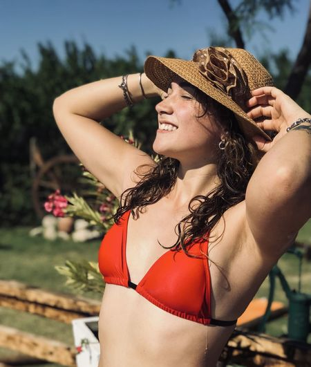 Midsection of woman wearing hat