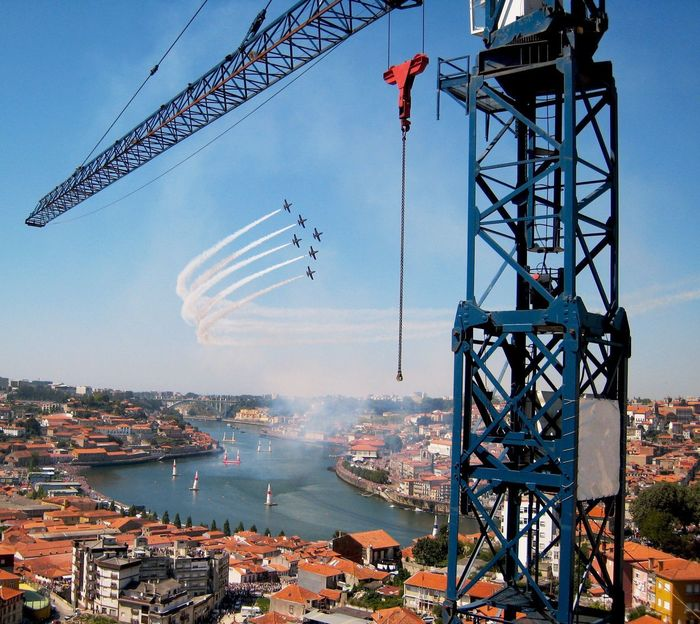 Sky Built Structure Architecture Outdoors Transportation Cityscapes Formation View From Above City Water No People Day Lines Airplane Flying EyeEm Best Shots RedBull Air Race Crane Check This Out Smoke River Riverside In Porto , Portugal MISSIONS: The Architect - 2017 EyeEm Awards The Street Photographer - 2017 EyeEm Awards