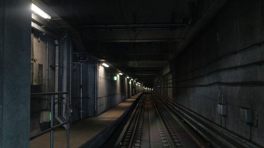 Interior of illuminated railroad tunnel