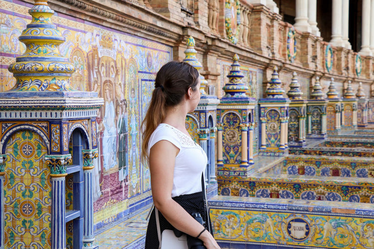 Woman admiring Plaza de Espana One Person Architecture Young Adult Standing Lifestyles Adult Day Built Structure Young Women Women Building Three Quarter Length Real People Leisure Activity Hairstyle Long Hair Side View Religion The Past Hair Outdoors Profile View Beautiful Woman Plaza De España