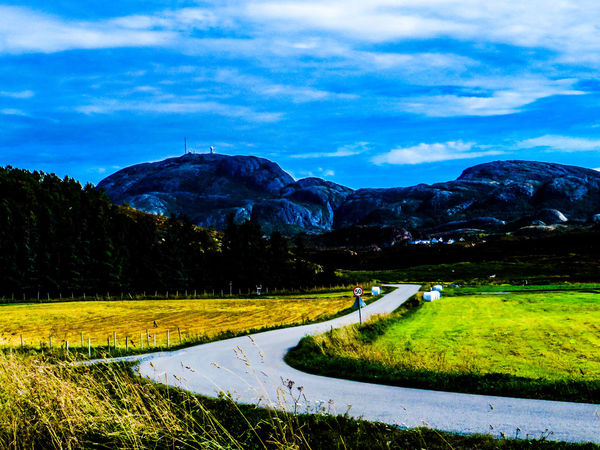 Enjoying The Sun EyeEm Nature Lover EyeEmNewHere Beauty In Nature Cloud - Sky Day Eyeemnorway Field Grass Landscape Mountain Nature Outdoors Road Scenics Sky Tranquility Summer Road Tripping