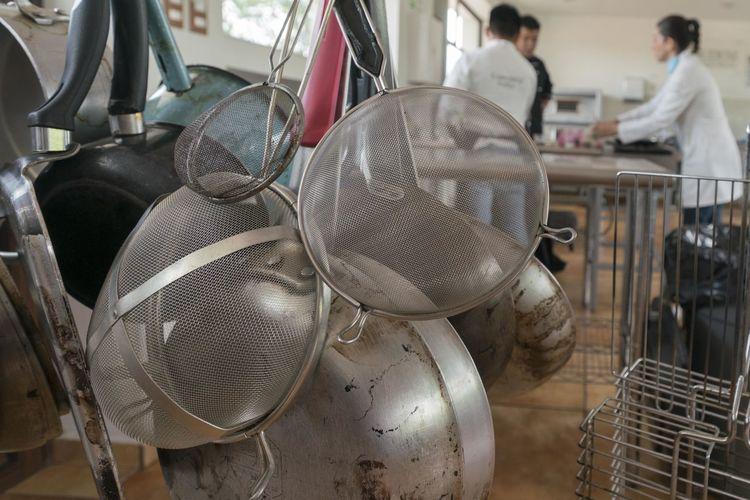 Close-up of kitchen utensils hanging indoors