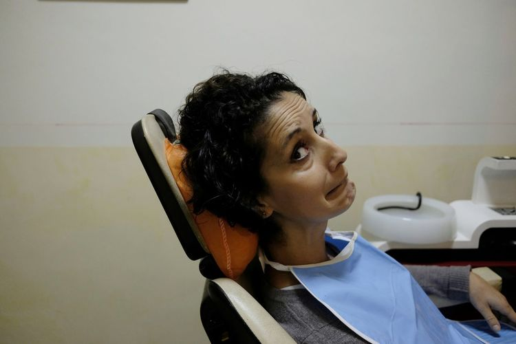 Afraid Dentist Fear Mouth Pain Toothache Day Exam Expression Facial Indoors  Jaw One Person Patient Real People Scared Teeth Tooth Treatment Young Adult Young Women