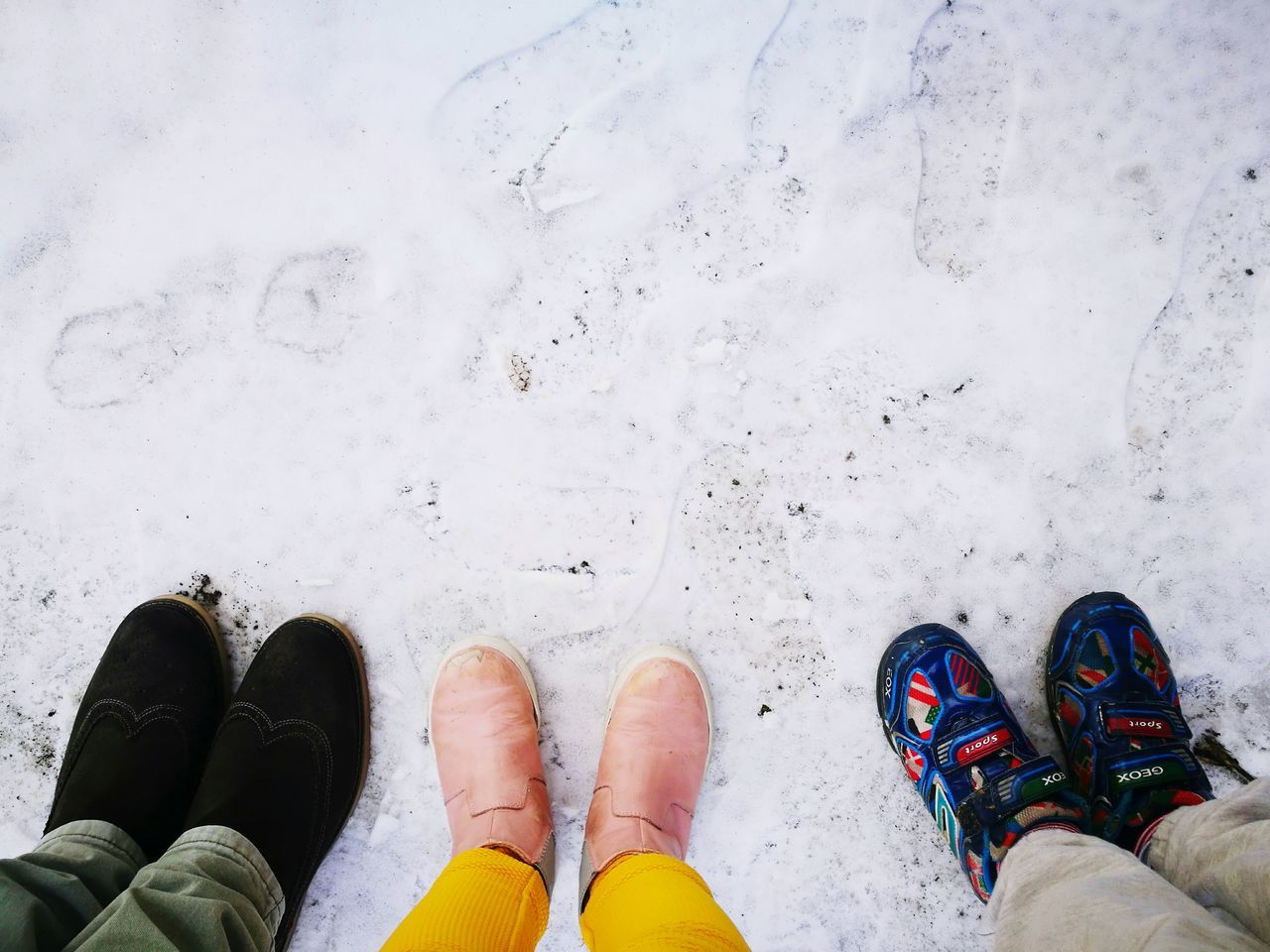 low section, human leg, shoe, standing, human body part, high angle view, cold temperature, winter, personal perspective, real people, pair, snow, day, lifestyles, men, outdoors, one person, nature, people