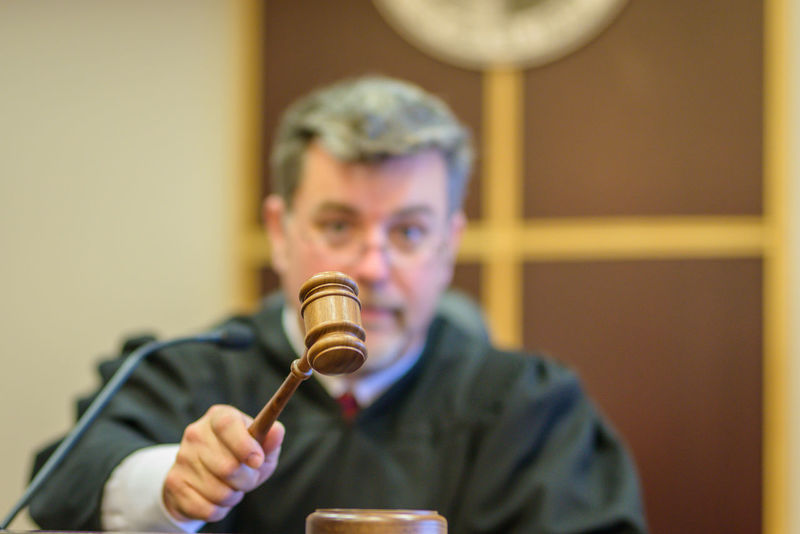 Male Judge with Gavel Bench Court Government Legal System Man USA Courthouse Courtroom Expression Gavel Handsome Judge Judge's Robe Judiciary Justice-concept Legal Trial Male Mature Adult Photography Punishment Real People Robe Working
