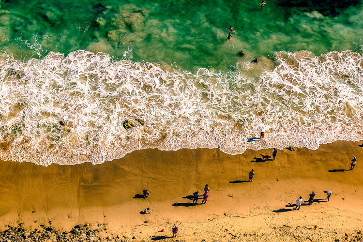 Life's a beach Beach Beauty In Nature Crowd Day Group Of People High Angle View Incidental People Land Large Group Of People Leisure Activity Lifestyles Men Motion Nature Outdoors Real People Sea Water Women