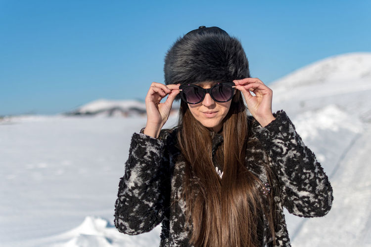 Winter Cold Temperature Snow One Person Warm Clothing Clothing Young Adult Mountain Nature Glasses Day Lifestyles Leisure Activity Front View Real People Young Women Hair Fashion Hairstyle Outdoors Beautiful Woman