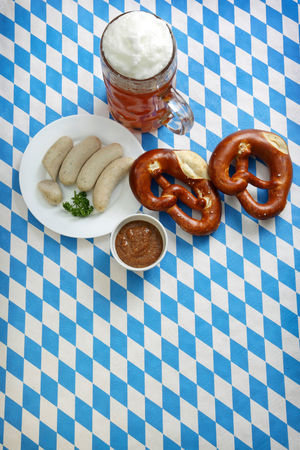 Holiday Tables on Vibrant colorful background - Bavarian October Fest Oktoberfest Party Beer Holidays Pretzels Sausages Weissbier Blue Colorful Festive Food Food And Drink Indoors  Mustard No People Pattern Still Life Table Top View Topview Weissbeer Weisswurst White Wurst
