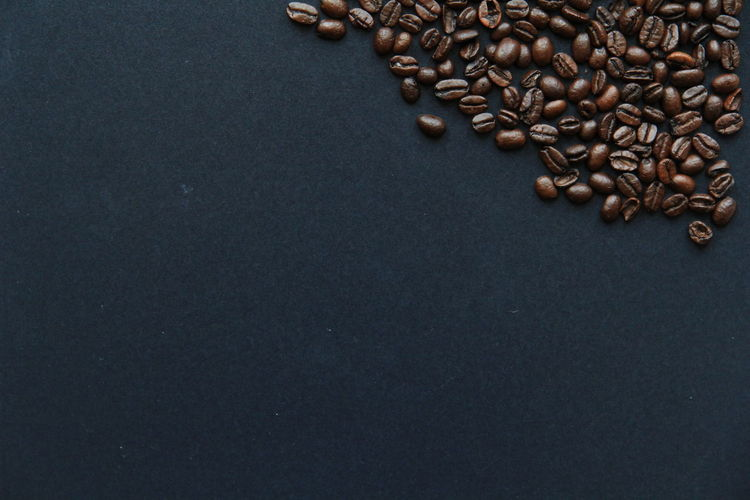 Coffee Food And Drink Coffee - Drink Roasted Coffee Bean Close-up Freshness High Angle View No People Studio Shot Table Food Brown Drink Caffeine Directly Above Refreshment Black Background Space Cafe