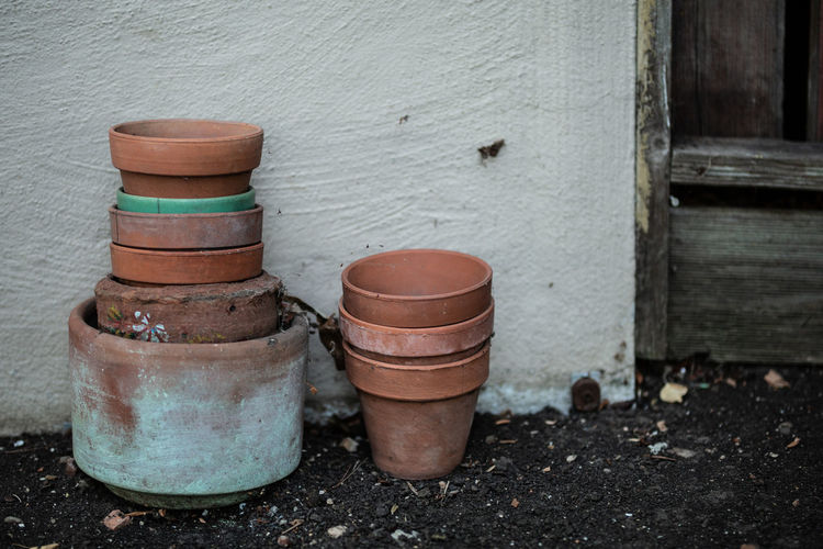 Container Barrel Wood - Material No People Cylinder Day Outdoors Wall - Building Feature Still Life Old Built Structure Group Of Objects Focus On Foreground Architecture Close-up Wall Nature Brown Plant Building Exterior Clay