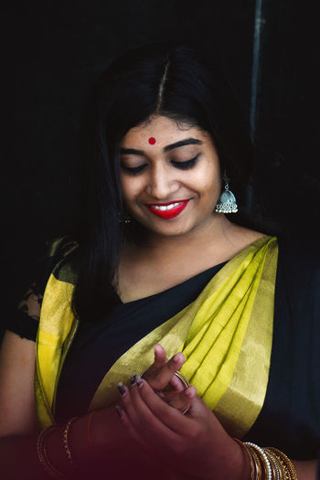 Smiling young woman in traditional clothing