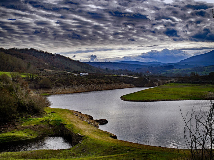 Cloud - Sky Sky Tranquil Scene Water Scenics - Nature Beauty In Nature Mountain Tranquility Plant Nature No People Grass Landscape Environment Lake Non-urban Scene Land Day Mountain Range Outdoors Flowing Water