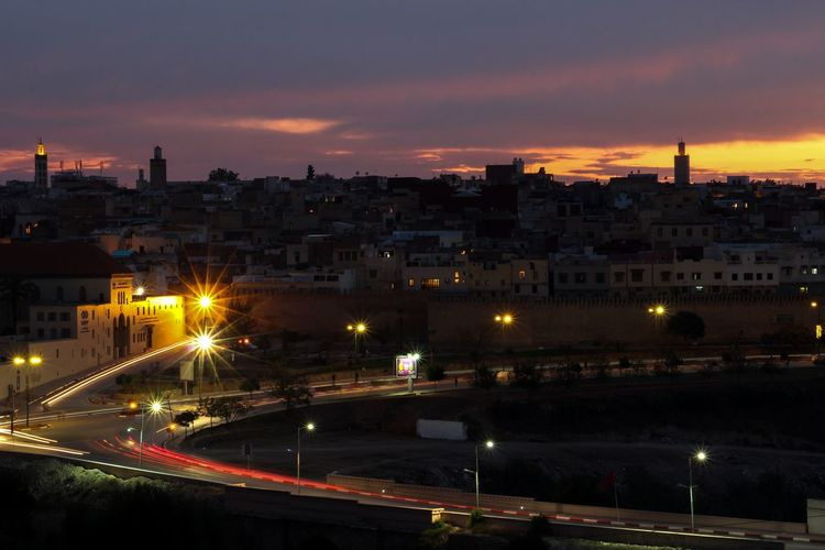 Beautiful sunset | Meknes City 🇲🇦 Morocco Meknès Building Exterior Architecture Illuminated Built Structure City Sky Street Cloud - Sky Long Exposure Light Trail EyeEmNewHere
