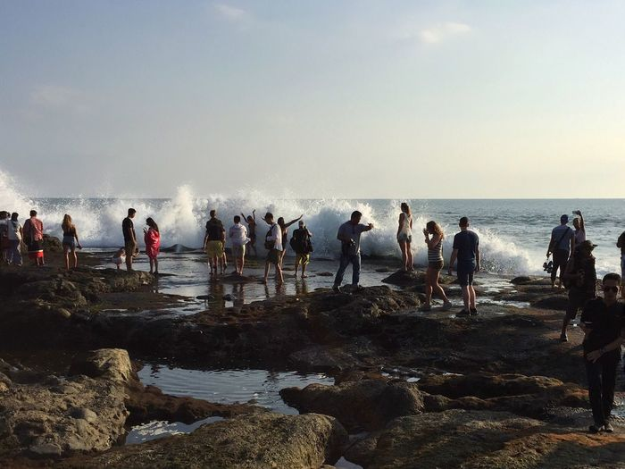 Sea Water Waves Crashing Beach Beach Action Nature's Power Wet Fun Ocean Spray Tourism Large Group Of People Leisure Activity Horizon Over Water Travel Destinations Tanah Lot Bali