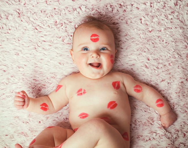 Newborn baby girl on the soft blanket filled kisses made with the lipstick. Lipstick New Born Photography New Born Adult Bed Bedroom Cheerful Childhood Close-up Day Front View Human Body Part Indoors  Lipstick ♥ Lipsticks Looking At Camera Mouth Open New Born Baby One Person People Portrait Real People Shirtless Smiling Wallpaper