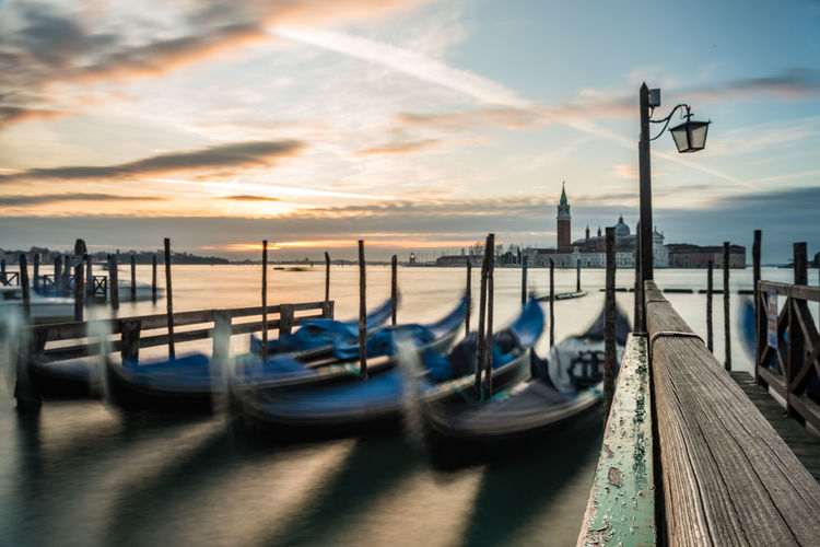 Gondolas moored on grand canal at sunset