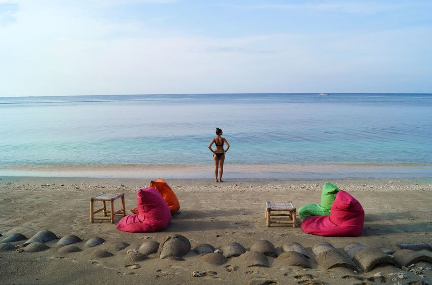 Bali Indonesia Beach Time Tropical Paradise Adult Beach Beauty In Nature Day Full Length Gili Air Gili Islands Horizon Horizon Over Sea Horizon Over Water Land Lifestyles Outdoors Real People Rear View Sand Scenics - Nature Sea Travel Vibes Water Women Women Sillouette