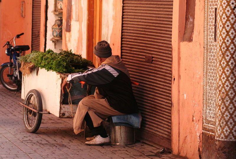 2011 Architecture Building Exterior City Closed Shop Day Full Length Lifestyles Marrakesh Mint Morocco Motorcycle One Man Only One Person Outdoors Real People Rear View Sitting