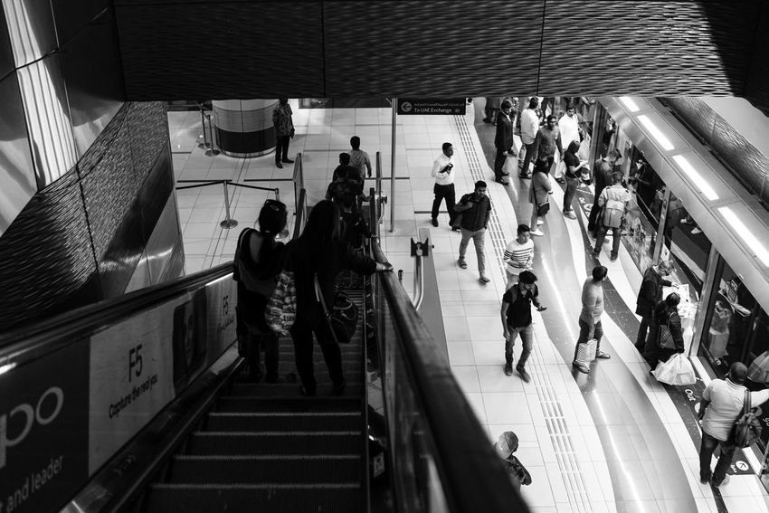 Metro Lfe, WeekOnEyeEm Architecture Black And White Photography Crowd Dubai, Escalator High Angle View Indoors  Large Group Of People Lifestyles monochrome photography People Public Transportation Real People Staircase Steps And Staircases Subway Station Week On Eyeem Women