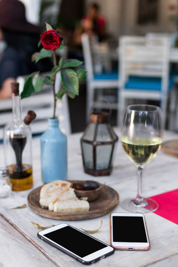 Ice cream and wine on table