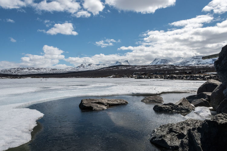 Lapporten from the water 3 Abisko Beauty In Nature Cloud - Sky Cold Temperature Day Frozen Hot Spring Iceberg Lake Landscape Lapporten Mountain Mountain Range Nature No People Outdoors Salt - Mineral Scenics Sky Snow Sweden Tranquil Scene Tranquility Water Winter