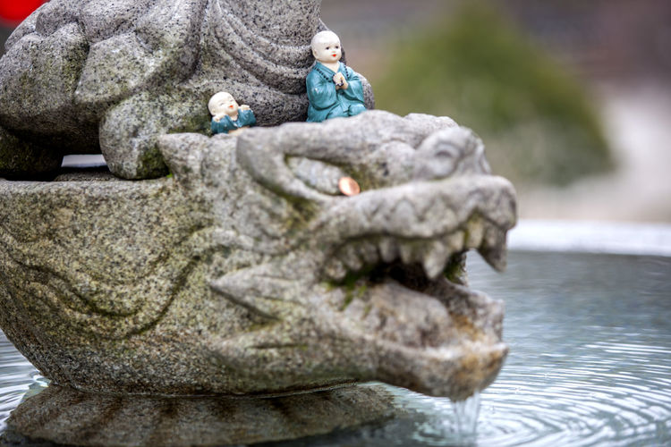 Figurines on sculpture in fountain