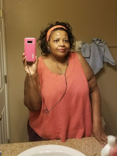 along the way Weightloss Journey Weightloss Pretty In Pink Woman Front View Smiling Happiness Indoors  Body Part Eyes Closeup Fabulously Fifty