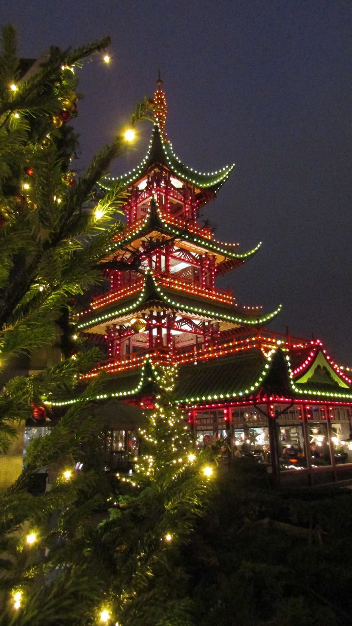 ILLUMINATED CHRISTMAS TREE AGAINST SKY AT NIGHT DURING FESTIVAL
