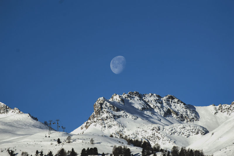 Sky Moon Scenics - Nature Beauty In Nature Winter Cold Temperature Tranquil Scene Snow Tranquility Mountain Blue Nature Astronomy Non-urban Scene Snowcapped Mountain No People Clear Sky Space Mountain Range Outdoors Mountain Peak Planetary Moon Saint Moritz