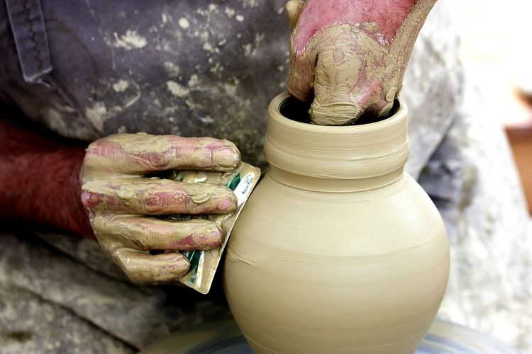 Midsection Of Potter Working