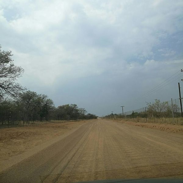 Been There. The Way Forward Cloud - Sky Sky Road Day Tree Rural Scene No People Tire Track Nature Outdoors Telephone Line Beauty In Nature 3XSPUnity HuaweiP9Photography Beauty In Nature Nature South Africa Dirt Road Dusty Track Bushes And Fences On The Road