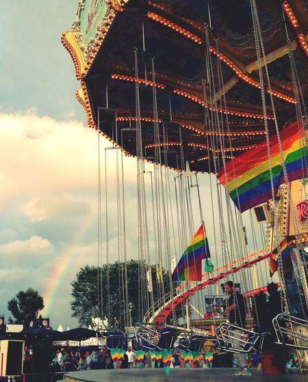Düsseldorf Rainbow Overkill Amusement Park Amusement Park Ride Arts Culture And Entertainment Leisure Activity Real People Enjoyment Fun Sky Men Lifestyles Outdoors Low Angle View Carousel Built Structure Day Large Group Of People Multi Colored People Rainbow Gay Pride Love Is Love