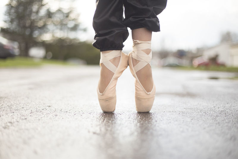A ballerina in ballet shoes in the street. Artist Beautiful Beautiful Nature Dance Dancing Road Ballet Concert Dancer Feet Ground Lower Half Pavement Pink Color Shoes Street Toes