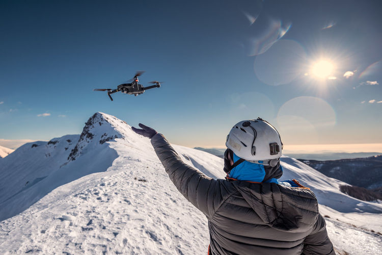Drone - DJI Winter Mountain Snow Cold Temperature Sky Scenics - Nature Snowcapped Mountain Air Vehicle Mid-air Sunlight Transportation Warm Clothing Freedom People Mountain Range Nature Rear View Beauty In Nature Flying Leisure Activity Real People Lifestyles Adventure Outdoors Trekking Snowing Winter Wintertime Winter Sport Nature Alpine Hiking Hikingadventures Outdoor Photography Outdoors Photograpghy  Travel Travel Destinations Tranquility EyeEm Nature Lover Adventure Time Travel And Tourism Alpinism Alpine Alpine Landscape Life In Motion Drone  Dji DJI Mavic Pro DJI X Eyeem Sunset Fly My Best Photo The Great Outdoors - 2019 EyeEm Awards