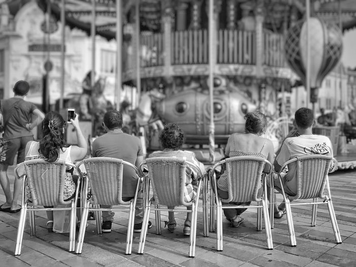 Looking after their children at the Carousel 😀 Orléans France Rear View Chair Sitting People Blackandwhite Moments Bnw Tourist Attraction  Travel Destinations Mobilephotography EyeEm IPhoneography Moment Iphoneonly IPhoneography Outofthephone Chairs Leisure Activity Streetphotography
