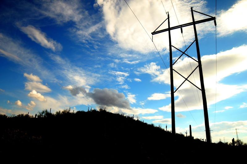 Silhouette of a pylon in the desert Desert Pylon Sky Cloud - Sky Silhouette Low Angle View Nature Technology No People Outdoors Sunset Connection Electricity Pylon Fuel And Power Generation Architecture Day Communication Beauty In Nature Built Structure Electricity  Plant