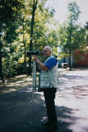 Senior Man Photographing On Street