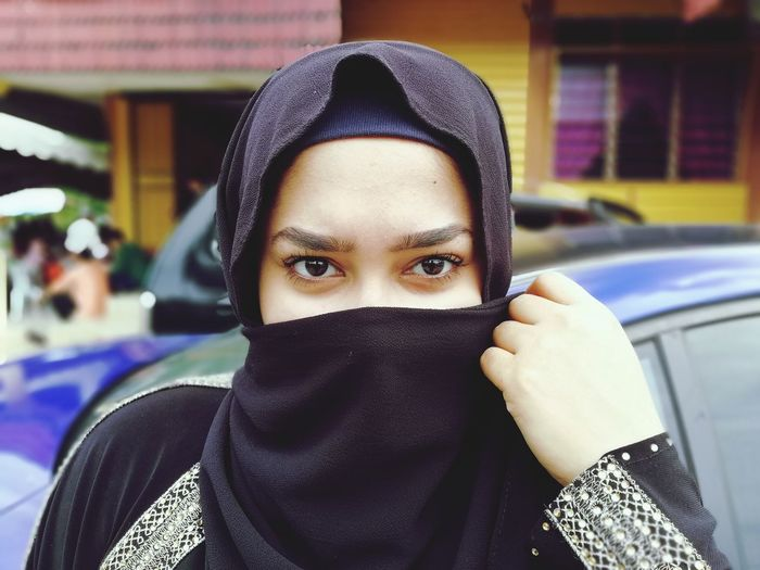 Close-up portrait of young woman wearing burkha